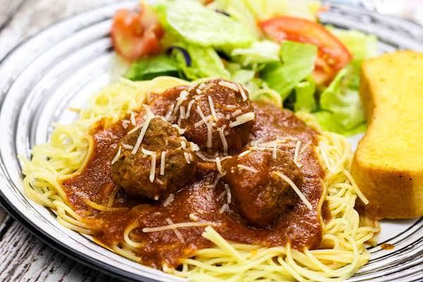 Homemade Italian Spaghetti Sauce And Meatballs Over Spaghetti.