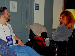 Photo: Daniese McMullin-Powell chats with a fellow advocate during Disability Day at Legislative Hall on 3.25.15.