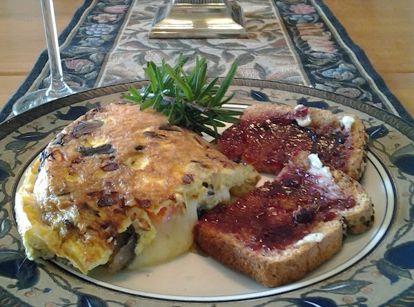 Lift omelet onto plate and cut in half to serve in 2 sections. (Note:...