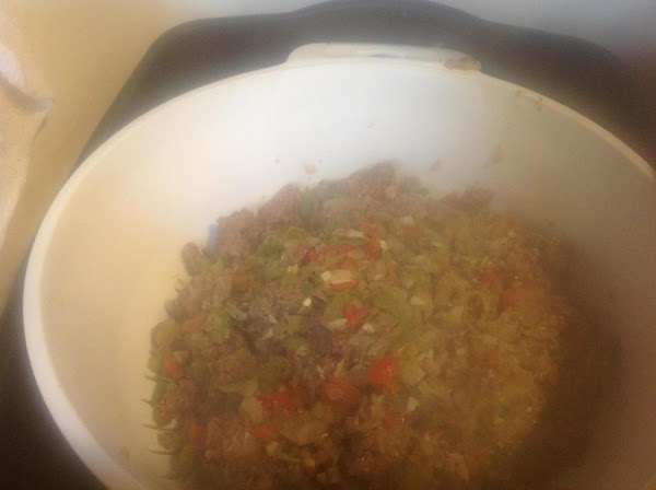 Drain the meat & veggies in a large colander, then add the meat back...