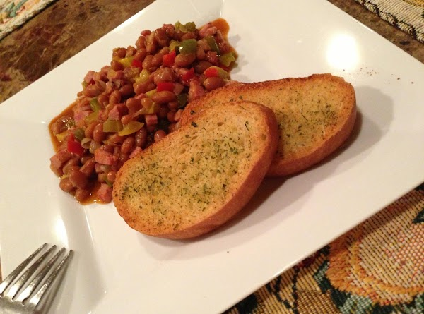 Serve with garlic bread. Enjoy your meal.