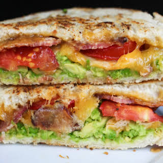 Grilled Cheese with Guacamole, Tomato, and Bacon.