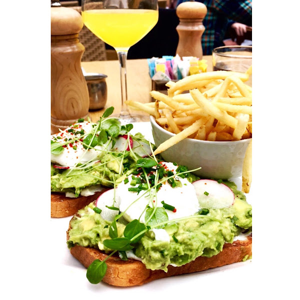 Avacado toast with poached eggs and fries!