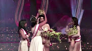 Pushpika De Silva's crown is removed from her head by the reigning Mrs World, Caroline Jurie, after Jurie declared that De Silva was ineligible to win the Mrs Sri Lanka pageant on April 4 2021.