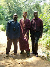 Photo: The man in the middle is the cheif of the village, Benade. He was one who was saved and baptized on this Sunday. He has already donated a very large piece of land for a church to be built in his village...but the laborers are few.