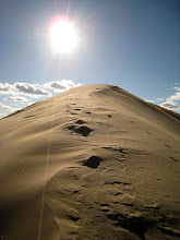 """Photo: The climb can be a bit strenuous and in certain parts we have the typical """"three steps forward, two back"""" pattern. This is the ridge of the highest dune. The first part is relatively easy, and things get much more interesting ahead, where the ridge is narrower. Slipping to the side won't hurt you, but you won't be able to climb it back the easy way."""