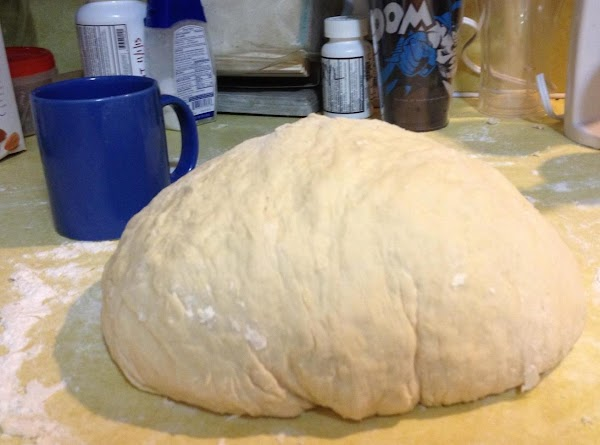 Using large workspace, dump dough onto a generously floured counter or table.  Knead...