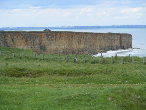 Photo: This cliff view gives a sobering reminder of the task faced by the Rangers that day. In fact, the most difficult tasks they faced were after the cliff assault, as they held out against German counterattacks over the next two days before being reinforced. Of the more than 225 Rangers in the initial assault, only about 90 were still combat-worthy when relief arrived.