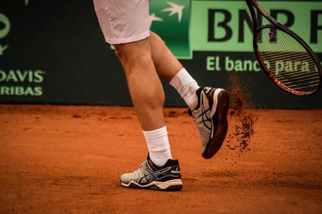 Tennis Shoes on a clay court