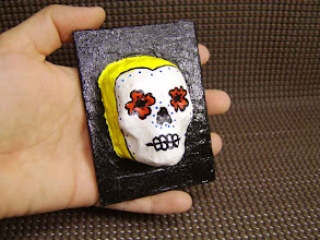 Photo: The Yellow Sugar Skull. (sold) 2.5 x 3.5 x 1.5 inches. Acrylics on papier-mâché  made from recycled store receipts. Sealed with a glossy varnish. Title and signature on the back. ©Marisol McKee.