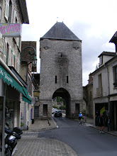 Photo: And here is the Porte de Bourgogne tower at the other end of la rue Grande. The information plaque notes that like its twin at the other end of the street, it was closed by both a portcullis and a wooden door. There were also openings on the exterior (bridge) side of the tower for dropping projectiles onto invaders.