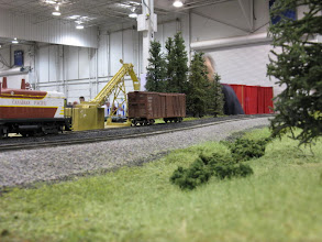 Photo: An O scale 'Red Devil' coal loader stands in for a sugar beet loader.