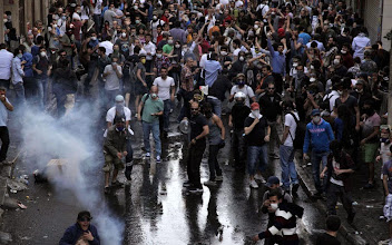 Photo: Protestors clash with Turkish riot policemen on May 31, 2013 during a protest against the demolition of the Taksim Gezi Park in Taksim Square in Istanbul. Police used tear gas to disperse a group, who were standing guard in Gezi Parki to prevent the Istanbul Metropolitan Municipality from demolishing the last remaining green public space in the center of Istanbul as a part of a major Taksim renewal project. At least a dozen people were injured.     AFP PHOTO/GURCAN OZTURK