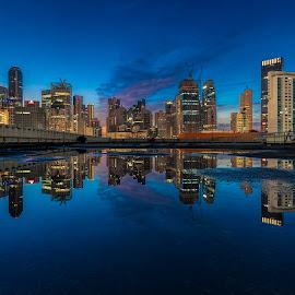 by Gordon Koh - City,  Street & Park  Skylines ( puddle, sunrise, reflection, city, asia, city park, clouds, skyline, epic sunrise, building, rain puddle, singapore, modern, urban, symmetry, cityscape, hotel, modern city, movement, blue hour, park, architecture )