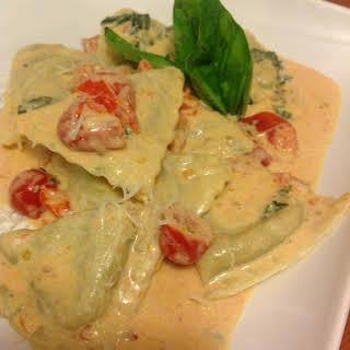 Spinach Ravioli with Tomato Basil Cream Sauce.