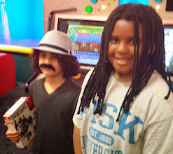 Photo: Kaleya and the birthday boy (who is rockin the fake mustache well)