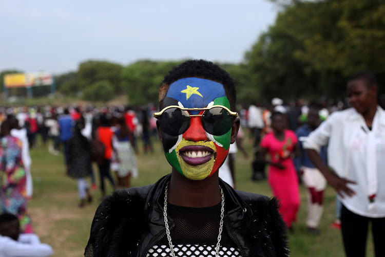 A South Sudanese girl with the national flag painted on her face poses for a portrait at the Nyakuron Cultural Centre in Juba.
