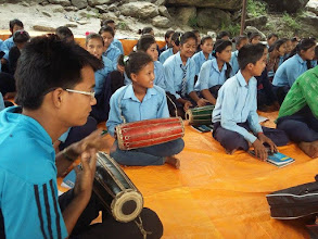 Photo: Children learning to play the madal