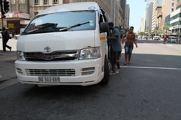 Commuters getting into a taxi: Image: File Photo