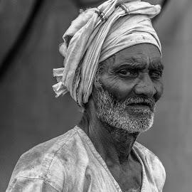 A lifetime on his furrowed brow by Hariharan Venkatakrishnan - People Portraits of Men