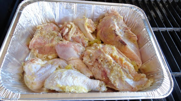 On an old cookie sheet or disposable pan place chicken and contents. I used...