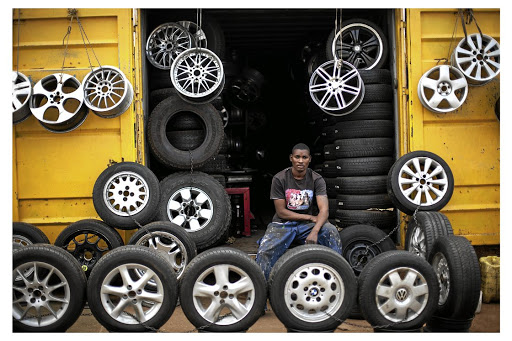 Soweto entrepreneur James Matsinhe at his tyre-and-mag shop. Picture: THE TIMES
