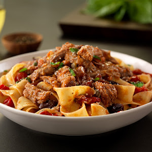 Pork Pappardelle Puttanesca with Basil and Pecorino Cheese