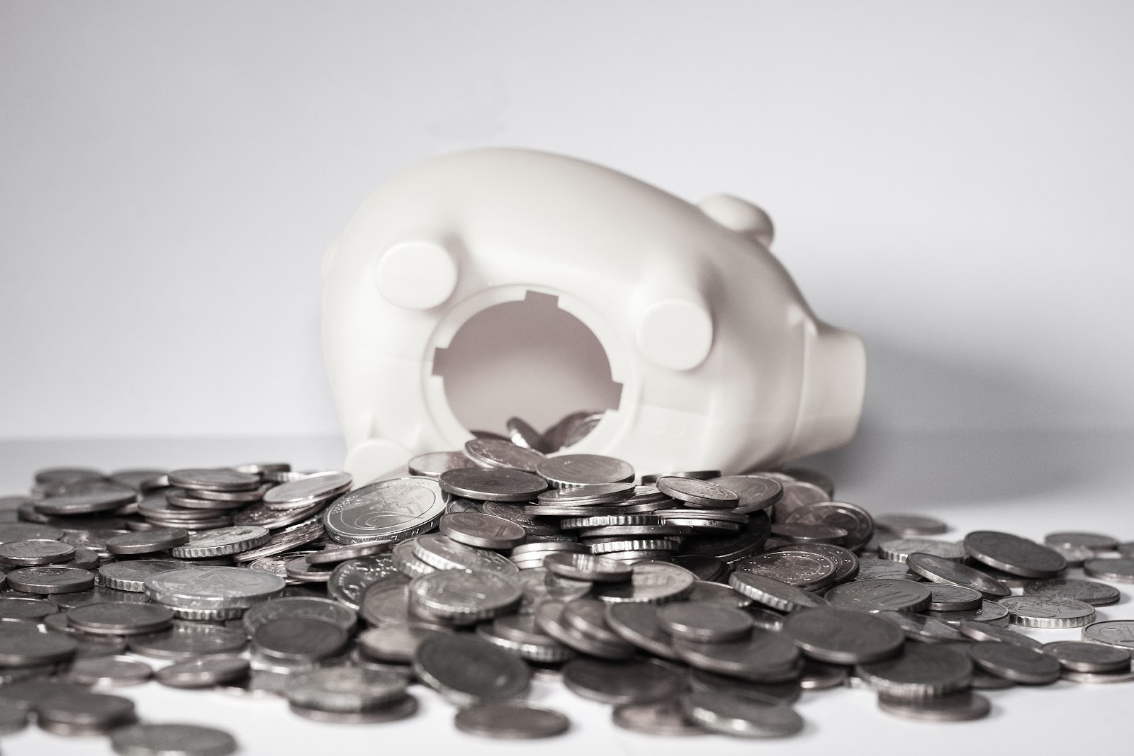 piggy bank with money spilling out