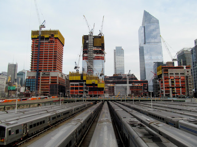 Several new buildings over the rail yard
