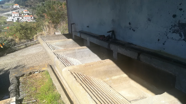 the washbasins outside were fed by the levada. Our house is visible in the background