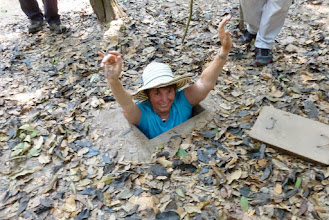 Photo: We went to the Cu Chi tunnels.  During the Vietnam war there were 125 miles of tunnels used by the Vietcong.   You need to bend your knees some and then fully bend at the waist to get through them.  I was happy to just get in and back out again about ten yards further on!