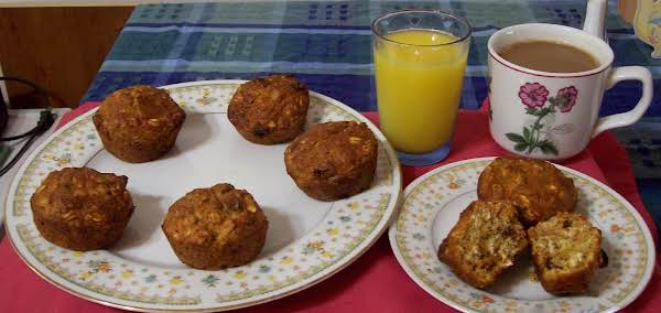 These Breakfast Muffins Are Moist And Very Nutritious; With Toasted Wheat Germ, Raisins, Oats, Carrots, A Banana, Buttermilk And Spices.  They Will Fill You Up With Healthy And Delicious Ingredients!