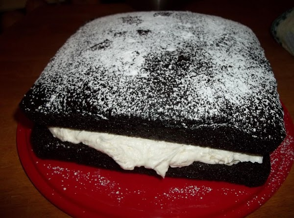 Spread the filling evenly on the bottom cake.Now, carefully Place the other cake, rounded...