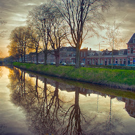 city houses along the canal by Egon Zitter - City,  Street & Park  Neighborhoods ( urban, reflection, houses, sunset, real estate, canal )
