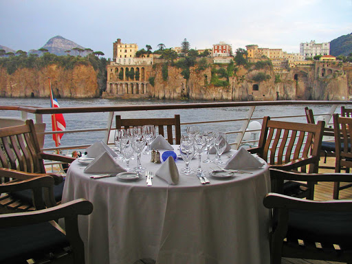 SeaDream-dinner-view.jpg - Enjoy sumptuous views of local landscapes on a SeaDream yacht.