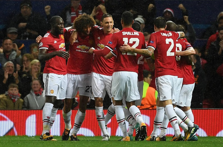 Marouane Fellaini of Manchester United celebrates scoring his sides first goal with his Manchester United team mates during the UEFA Champions League Group A match between Manchester United and FC Basel at Old Trafford on September 12, 2017 in Manchester, United Kingdom.
