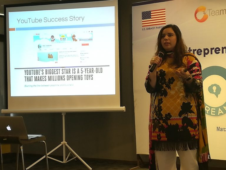 Woman holding a presentation about a YouTube success story.