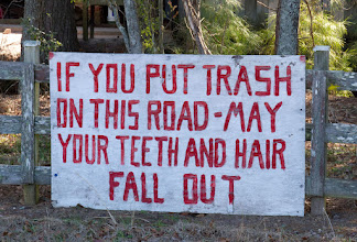 Photo: I know we're not going to use this in the project, but I just love this sign on a fence next to the road into Reed Bingham.