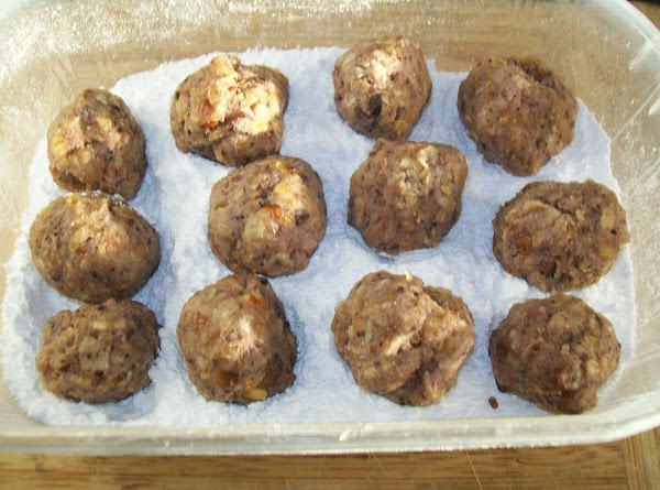OPTIONS: 1.Roll the truffles into small bite size pieces { I use my melon baller...