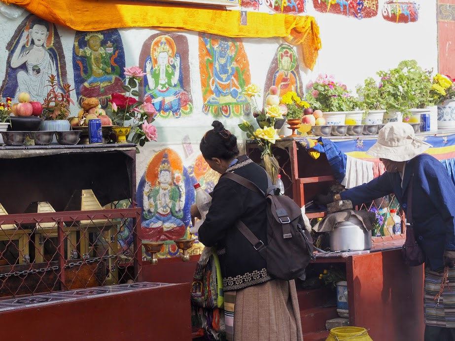 Everywhere around Lhasa you see burning incense, colorful offerings, and prayer flags. It's just so colorful!