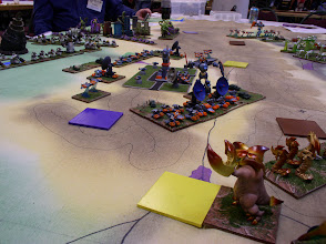 Photo: A Closer view of the Planet Eaters.  All of the colored squares are power centers, with each different color corresponding to a specific alien faction.  In the foreground, Zorog (complete with giant lobster claws) assaults a yellow power center.
