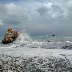 A wave hits a rock by Anastasis Agathokleous - Landscapes Waterscapes ( rock, waves, sky, waterscape, beach, cloudscape, clouds,  )