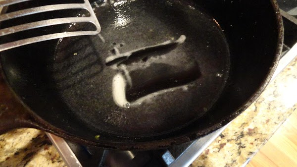 Heat up a cast iron skillet with Pam cooking spray.