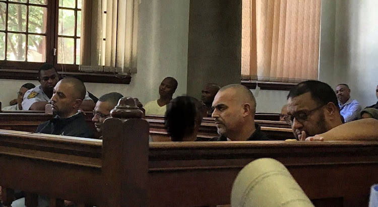 Nafiz Modack, Colin Booysen, Ashley Fields (obscured), Jacques Cronje and Carl Lakay in the dock at Cape Town Magistrate's Court. File photo