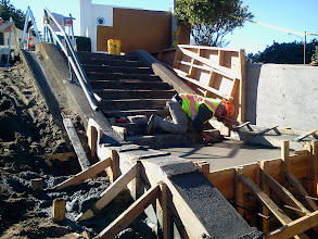 Photo: San Francisco Department of Public Works employee working after second pouring of concrete on Hidden Garden Steps  (16th Avenue, between Kirkham and Lawton streets in San Francisco's Inner Sunset District) in February 2013; for more information about the Hidden Garden Steps project, please visit http://hiddengardensteps.org.