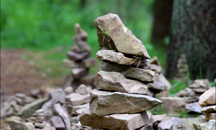 cairn on hiking trail.