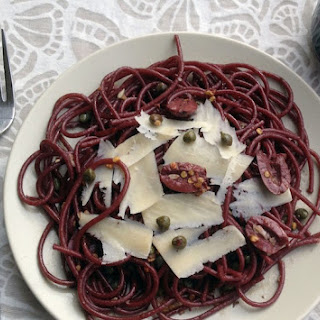 Drunken Spaghetti (Red Wine Spaghetti) with Olives, Capers, and Shaved Parmesan.