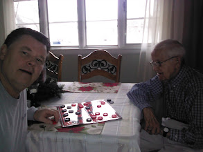 Photo: Scott and Rex playing checkers