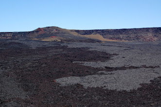 """Photo: From the bottom of the rockfall you can cross the caldera floor (over some truly terrible a`a) and reach the pumice slopes of the 1949 Cone. From there it is possible to climb to the caldera rim and enjoy a spectacular hike along the top of the cliffs to the Mauna Loa summit. This is infinitely more scenic than the """"official"""" route."""