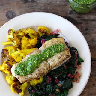 Seared Fish with Sauce Verte, Cauliflower, Preserved Lemon and Chard.
